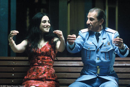 Sasson Gabai as Tewfiq and Ronit Elkabetz as Dina in
