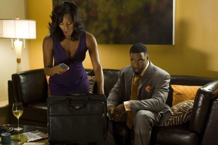 Tasha Smith as Angela and Michael Jai White as Marcus in