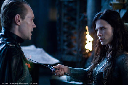 Steven Mackintosh as Tannis and Rhona Mitra as Sonja in
