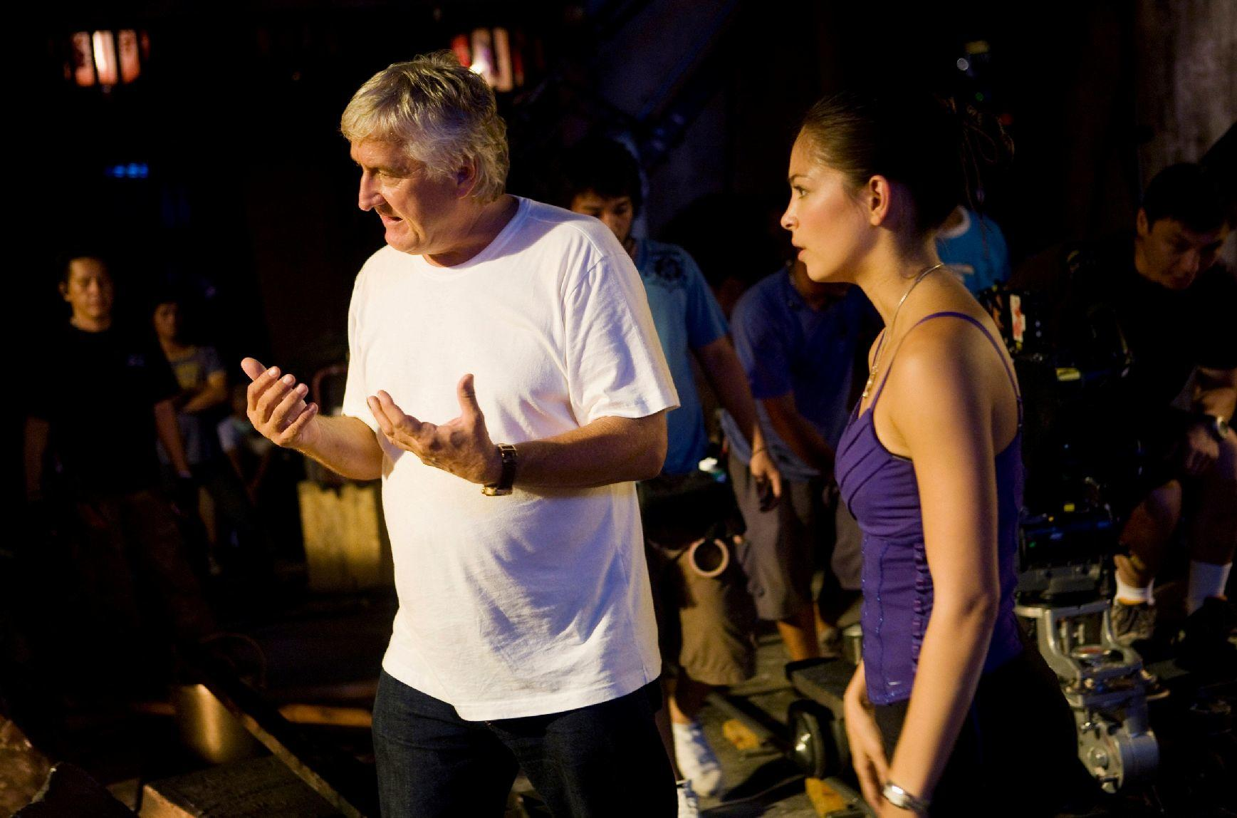Director Andrzej Bartkowiak and Kristin Kreuk on the set of