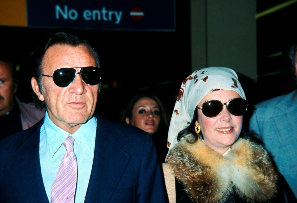 Richard Burton and Elizabeth Taylor in London, England for his 50th Birthday.