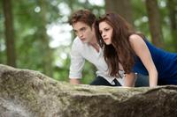 Robert Pattinson as Edward Cullen and Kristen Stewart as Bella in Twilight