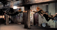 Keanu Reeves as Neo and Hugo Weaving as Agent Smith in The Matrix