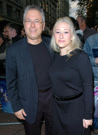 Alan Menken and Guest at the premiere of