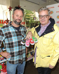 Mark Mothersbaugh and Guest at the Vans x Yo Gabba Gabba! shoe launch in California.