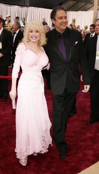 Dolly Parton and Duncan Tucker at the 78th Annual Academy Awards.