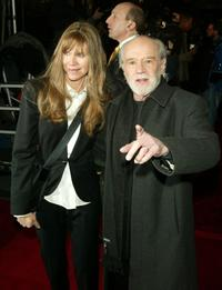 George Carlin and date at the premiere of