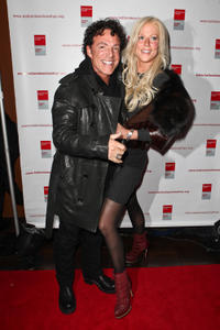 Neal Schon and Michaele Salahi at the Bottomless Closet fall 2012 fashion show during the Mercedes-Benz Fashion Week in New York.