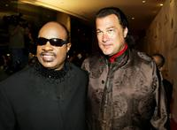 Stevie Wonder and Steven Seagal at the Tribute To Ray Charles Benefit Concert.