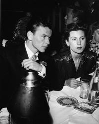 Frank Sinatra and first wife Nancy Barbatto at a restaurant.