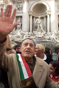 Alberto Sordi waves at the Trevi Foutain in Rome,after throwing his last Italian Lire.