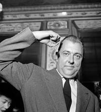 Jacques Tati gestures to the media in Paris.
