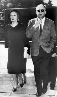 Marlene Dietrich and Billy Wilder as they walk together.
