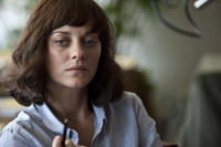 Marion Cotillard as Dr. Leonora Orantes in ``Contagion.''