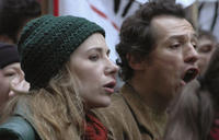 Anna's parents Marie (Julie Depardieu) and Fernando (Stefano Accorsi) at a political rally in