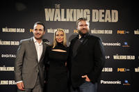 Andrew Lincoln, Laurie Holden and writer Robert Kirkman  at the premiere of