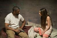 Denzel Washington as Eli and Mila Kunis as Solara in
