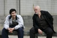 Tahar Rahim as Malik and Niels Arestrup as Cesar Luciani in
