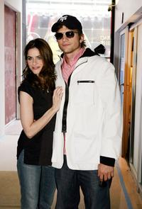 Amanda Peet and Ashton Kutcher at the MTV's Total Request Live.