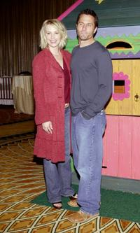 Josie Bissett and her husband Rob Estes at the 2002 Lullabies and Luxuries Fashion Event.