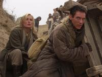 Radha Mitchell as Lee Pearson and Jonathan Rhys Meyers as George Hogg in