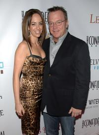Tom Arnold and Guest at the Los Angeles Confidential Magazine's Pre-Emmy Party.