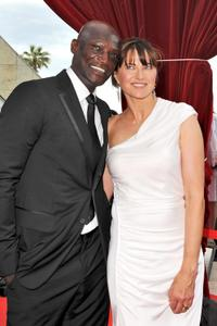 Peter Mensah and Lucy Lawless at the Closing Ceremony during the 2010 Monte Carlo Television Festival.