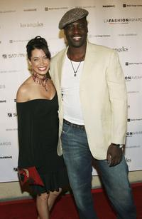 Adewale Akinnuoye-Agbaje and Guest at the 2006 Los Angeles Fashion Awards.