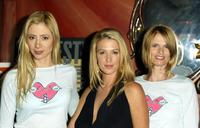 Mira Sorvino, Poppy Montgomery and Tracy Wilkinson at the Fashion Week event.