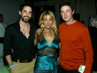 Adam Kaufman, Poppy Montgomery and Eric Close at the CBS and UPN Winter Press Tour party.