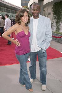 Dule Hill and guest at the premiere of