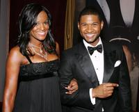 Usher Raymond and girlfriend at the 15th annual Trumpet Awards.