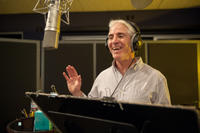 Carlos Alazraqui on the set of