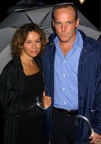 Jennifer Grey and her husband Clark Gregg at the rainy openning night of