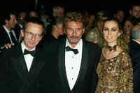 Director Patrice Leconte, Johnny Hallyday and Laeticia Hallyday at the 2002 Marrakech International Film Festival.