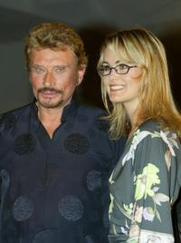 Johnny Hallyday and Laeticia Hallyday at the screening of