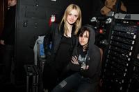 Dakota Fanning and Kristen Stewart backstage at Joan Jett's concert at Sundance Film Festival 2010.