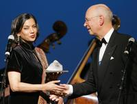 Shabana Azmi and Klaus Schwab at the World Economic Forum during a ceremony.
