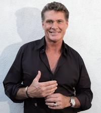 David Hasselhoff poses for a photograph before signing copies of his new book