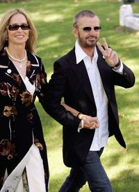 Barbara Bach and her husband Ringo Starr at the wedding of musician Jools Holland and Christabel McEwen at St James's Church.