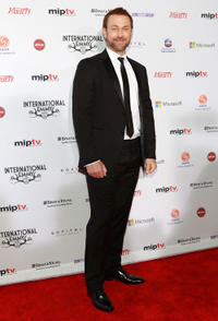 Grant Bowler at the 40th International Emmy Awards in New York City.