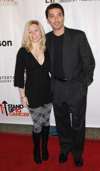 Scott Baio and Guest at the SU2C Merchandise Collection Launch party.