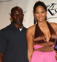Djimon Honsou and Kimora Lee Simmons at the Baby Phat fashion show.