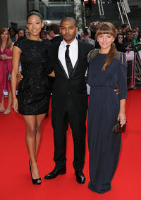 Shanika Warren-Markland, Noel Clarke and Ophelia Lovibond at the Red Carpet of National Movie Awards 2010 in London.