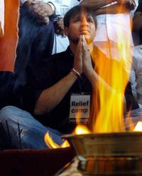 Vivek Oberoi at the puja (religious ceremony) at relief camp in a fishing village near Cuddalore.
