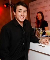 Alex Frost at the Belvedere Luxury Lounge in honor of 80th Academy Awards.