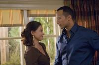 Ashley Judd as Carly and Dwayne Johnson as Derek Thompson in
