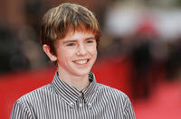 Freddie Highmore at the premiere of