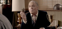 Stacy Keach as Warden Merville in