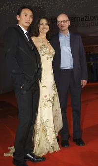 Chang Chen, Ele Keats and Director Steven Soderbergh at the premiere of